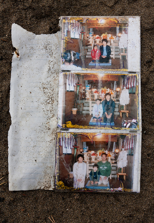 A photo album in the ruined landscape of Shimo Masuda near Sendai airport. Residents had 30 minutes to flee the tsunami after a magnitude 9 earthquake struck off the coast on March 11th leveling the town killing large numbers of people. Shimo Masuda, Sendai, Miyagi, Japan. Wednesday May 4th 2011