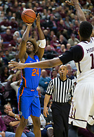 Florida guard Deaundrae Ballard (24) attempts a three point shot over Texas A&M center Tonny Trocha-Morelos (10) during the second half of an NCAA college basketball game Tuesday, Jan. 2, 2018, in College Station, Texas. (AP Photo/Sam Craft)