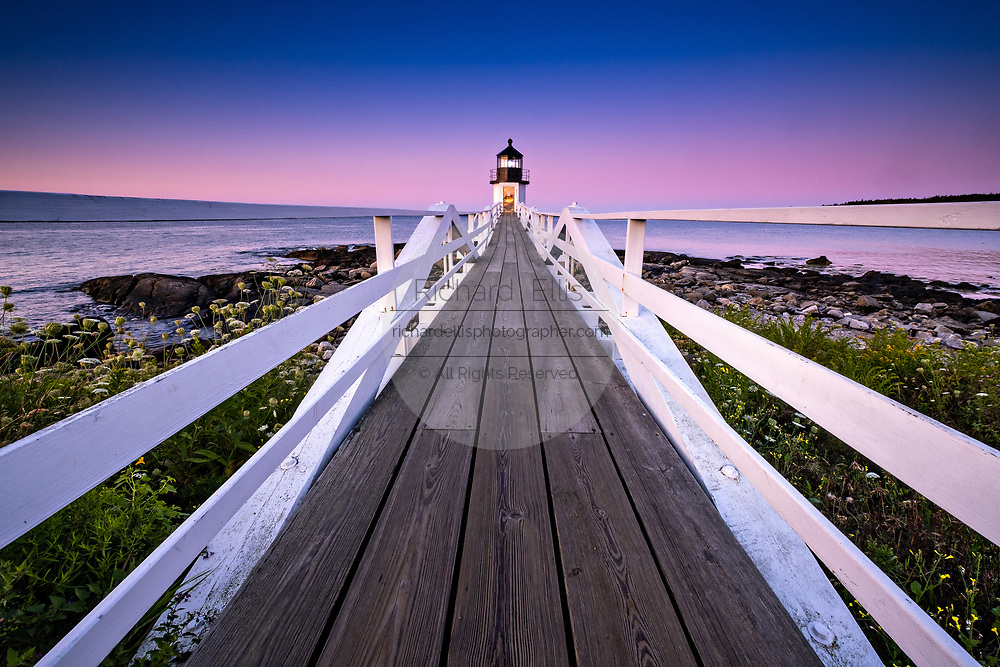 Dawn breaks over the Marshall Point Lighthouse near Port Clyde, Maine. The current lighthouse was built in 1832 on a rocky point of land near the mouth of Port Clyde Harbor and was featured in the major motion picture Forrest Gump.