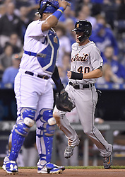 September 26, 2017 - Kansas City, MO, USA - The Detroit Tigers' JaCoby Jones, right, scores past Kansas City Royals catcher Salvador Perez on a single by Ian Kinsler in the third inning at Kauffman Stadium in Kansas City, Mo., on Tuesday, Sept. 26, 2017. (Credit Image: © John Sleezer/TNS via ZUMA Wire)