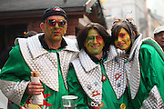 Switzerland, three people celebrating at a local festival