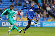 Kenneth Zohore of Cardiff city ® puts pressure on Derby county goalkeeper Scott Carson. EFL Skybet championship match, Cardiff city v Derby County at the Cardiff city stadium in Cardiff, South Wales on Saturday 30th September 2017.<br /> pic by Andrew Orchard, Andrew Orchard sports photography.