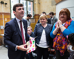 © Licensed to London News Pictures . 17/08/2015 . Manchester , UK . Labour party leadership contender , ANDY BURNHAM is given a piece of art by eight year old Armeet Uppal after delivering a speech at the People's History Museum in Manchester this morning (Monday 17th August 2015) . Photo credit : Joel Goodman/LNP