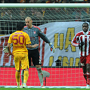 Galatasaray's Engin Baytar (L) and Sivasspor's goalkeeper Milan Borjan (C), Doudou Jacques Faty (R) during their Turkish Superleague soccer match Galatasaray between Sivasspor at the Turk Telekom Arena at Aslantepe in Istanbul Turkey on Saturday 26 November 2011. Photo by TURKPIX