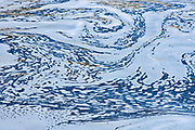 Abstract pattern of water swirling in Liscombe River<br />