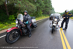 Jim Gilfoyle (L) and Joe Burch waiting out a construction closure during the Cross Country Chase motorcycle endurance run from Sault Sainte Marie, MI to Key West, FL. (for vintage bikes from 1930-1948). Stage 1 from Sault Sainte Marie to Ludington, MI USA. Friday, September 6, 2019. Photography ©2019 Michael Lichter.
