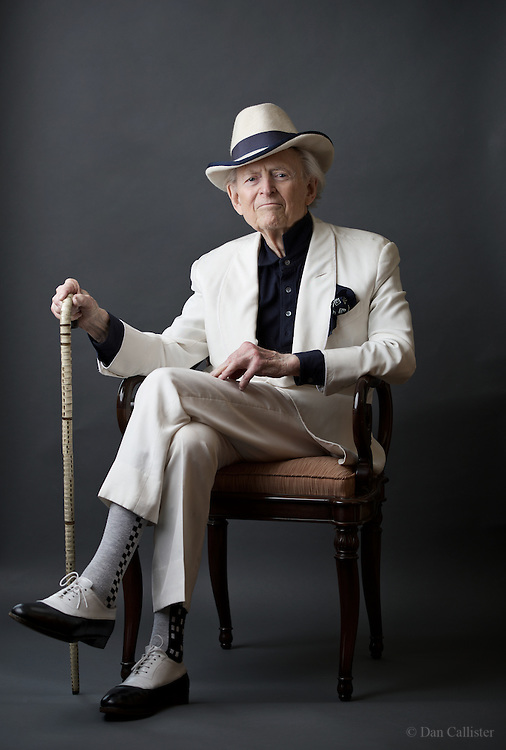"""Photograph by © Dan Callister <br /> www.dancallister.com<br /> Thomas Kennerly """"Tom"""" Wolfe, (born March 2, 1931) October 13, 2016 is an American author and journalist, best known for his association with and influence over the New Journalism literary movement, in which literary techniques are used extensively and traditional values of journalistic objectivity and evenhandedness are rejected. He began his career as a regional newspaper reporter in the 1950s, but achieved national prominence in the 1960s following the publication of such best-selling books as The Electric Kool-Aid Acid Test (a highly experimental account of Ken Kesey and the Merry Pranksters), and two collections of articles and essays, Radical Chic & Mau-Mauing the Flak Catchers and The Kandy-Kolored Tangerine-Flake Streamline Baby. His first novel, The Bonfire of the Vanities, published in 1987, was met with critical acclaim, became a commercial success, and was adapted as a major motion picture (directed by Brian De Palma).<br /> [Exclusive]<br /> [ Pictures]<br /> **© DAN CALLISTER. FEE MUST BE AGREED BEFORE USAGE. NO WEB USAGE WITHOUT APPROVAL. ALL RIGHTS RESERVED** <br /> Tel: +1 347 649 1755<br /> Mob: +1 917 589 4976<br /> E-mail: dan@dancallister.com<br /> Web:  www.dancallister.com<br /> 3149 41st St, #3rd Floor, Astoria, NY 11103 USA<br /> Photograph by © DAN CALLISTER  www.dancallister.com"""