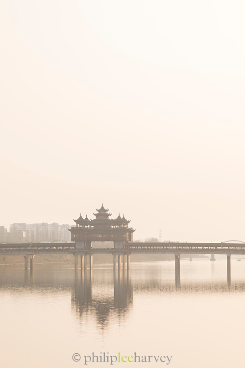 Old Chinese style bridge and lake under clear sky, Wenfeng Bridge, Tunxi district, Huangshan City, Anhui Province, China