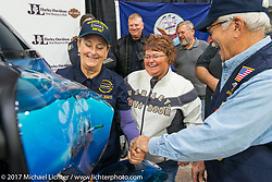 Captain Debra Bodenstedt of Yankton, USN Ret and chairwoman of the commissioning committee shows off features of the 2018 Harley-Davidson Street Glide donated by the Motor Company and customized by J and L Harley-Davidson to commemorate the christening of the USS South Dakota submarine. Sioux Falls, SD. USA. Monday October 9, 2017. Photography ©2017 Michael Lichter.