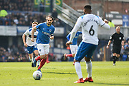 Portsmouth Forward, Brett Pitman (8) closes down Rochdale Defender, Ethan Ebanks-Landell (6) during the EFL Sky Bet League 1 match between Portsmouth and Rochdale at Fratton Park, Portsmouth, England on 13 April 2019.