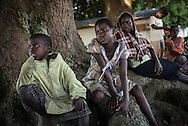 DRC / Burundi Refugees / Refugee children seat under a mango tree in Kavimvira transit centre in Uvira, DRC's<br /> South Kivu Province.<br /> 700 vulnerable Burundian refugees are hosted in Kavimvira transit centre. The<br /> majority are women and children.<br /> <br /> More than 9000 Burundians refugees have crossed into the DRC over the past few weeks. The new<br /> arrivals are being hosted by local families, but the growing numbers are straining<br /> available support. UNHCR is helping some 700 vulnerable refugees at a transit centre<br /> at Kavimvira and in another centre at Sange. Work is ongoing to identify a site<br /> where all the refugees can be moved, and from where they can have access to<br /> facilities such as schools, health centers and with proper security. / UNHCR / F.Scoppa / May 2015