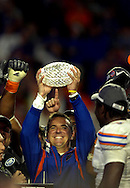 Broward, Miami Gardens, Fl. 1/8/2009 -2009 FedEx BCS NATIONAL CHAMPIONSHIP-Florida Gators head coach Urban Meyer holds up the trophy after winning  the FedEx BCS National Championship game at Dolphin Stadium on January 8, 2009 in Miami, Florida.  PHOTOS  20 OF IMAGES STAFF MICHAEL SPOONEYBARGER ORG XMIT: T0901090005329711