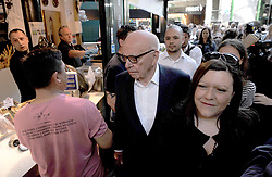 Rupert Murdoch views market stalls in Borough Market which has opened for the first time since the London Bridge terrorist attack.