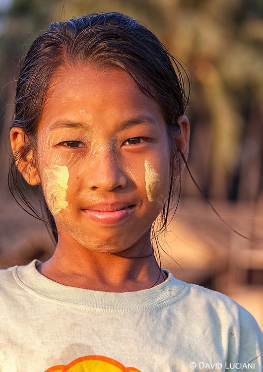 A girl posing before dusk at Ngapali beach near Gyeiktaw Village.