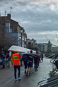 Hammersmith. London. United Kingdom,  Crew walking their boat to the Furnivall SC pontoon. 2018 Men's Head of the River Race.  location Barnes Bridge, Championship Course, Putney to Mortlake. River Thames, <br /> <br /> Sunday   11/03/2018<br /> <br /> [Mandatory Credit:Peter SPURRIER Intersport Images]<br /> <br /> Leica Camera AG  M9 Digital Camera  1/500 sec. 50 mm f. 160 ISO.  17.5MB