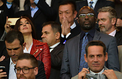 File photo : Monica Bellucci and George Weah during the UEFA Champions league quarter-final first leg football match PSG vs FC Barcelona at the Parc des Princes stadium in Paris on April 15, 2015. Former football star George Weah has been elected as Liberia's president. Mr Weah is well ahead of opponent Joseph Boakai with more than 60% of the vote. Photo by Christian Liewig/ABACAPRESS.COM