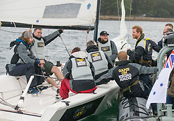 Prince Harry meets sailors participating in a yacht race in Sydney harbour during a day of events to mark the official launch of the Invictus Games Sydney 2018.