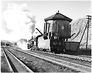 D&RGW #484 taking on water at Durango.  Two spouts on tank.<br /> D&RGW  Durango, CO