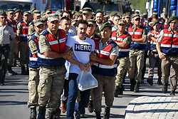 July 13, 2017 - Mugla, Turkey - One of the suspected members of the Gulenist Terror Group (FETO) - linked assassination squad which had been sent to kill President Recep Tayyip Erdogan during the coup bid on July 15 appeared before trial Thursday wearing a T-shirt that read: 'Hero.' GOKHAN GUCLU, who was wearing the T-shirt, and 43 other defendants stood before Mugla Second Heavy Penal Court as a third trial over Erdogan assassination plot began. (Credit Image: © Depo Photos via ZUMA Wire)