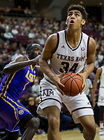 Texas A&M center Tyler Davis (34) looks to shoot after getting by LSU forward Duop Reath (1) during the first half of an NCAA college basketball game Saturday, Jan. 6, 2018, in College Station, Texas. (AP Photo/Sam Craft)
