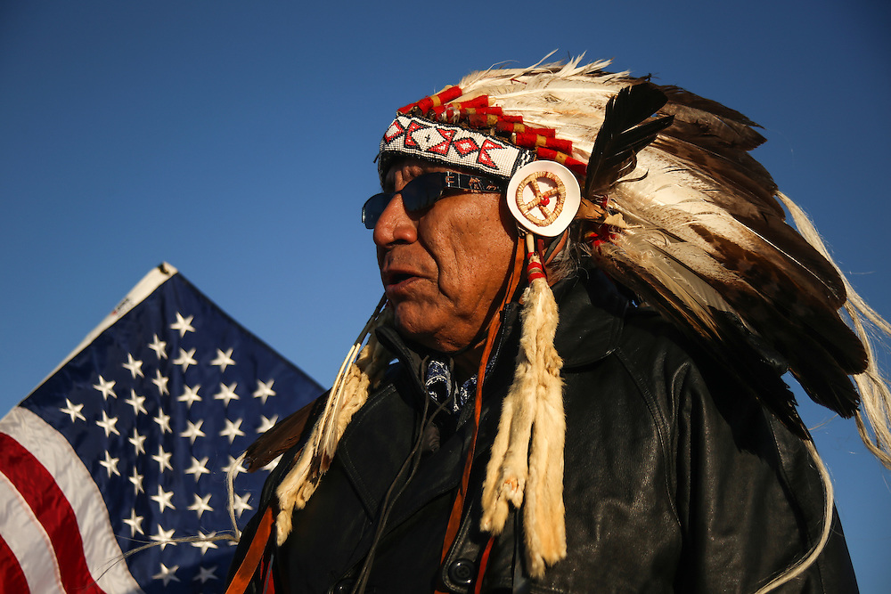 Chief Arvol Looking Horse speaks to members of the Woodland Cree Tribe at the pipeline protest site located on US Army Corps land in Cannon Ball, North Dakota in January 2017.<br /> <br /> Land managed by the Army Corps of Engineers where the pipeline has been routed is disputed by protestors to be land of the Standing Rock Sioux Tribe as a result of the 1851 Treaty of Fort Laramie. The treaty established Native American territories and interaction between the tribe and the United States, but was not respected by non-Indians. The treaty council met again to resolve some of these issues in the 1868 Treaty of Fort Laramie establishing specific territorial boundaries and land cessions to the United States. Through the new treaty, the Sioux lost land and would continue to lose land in the following decades.
