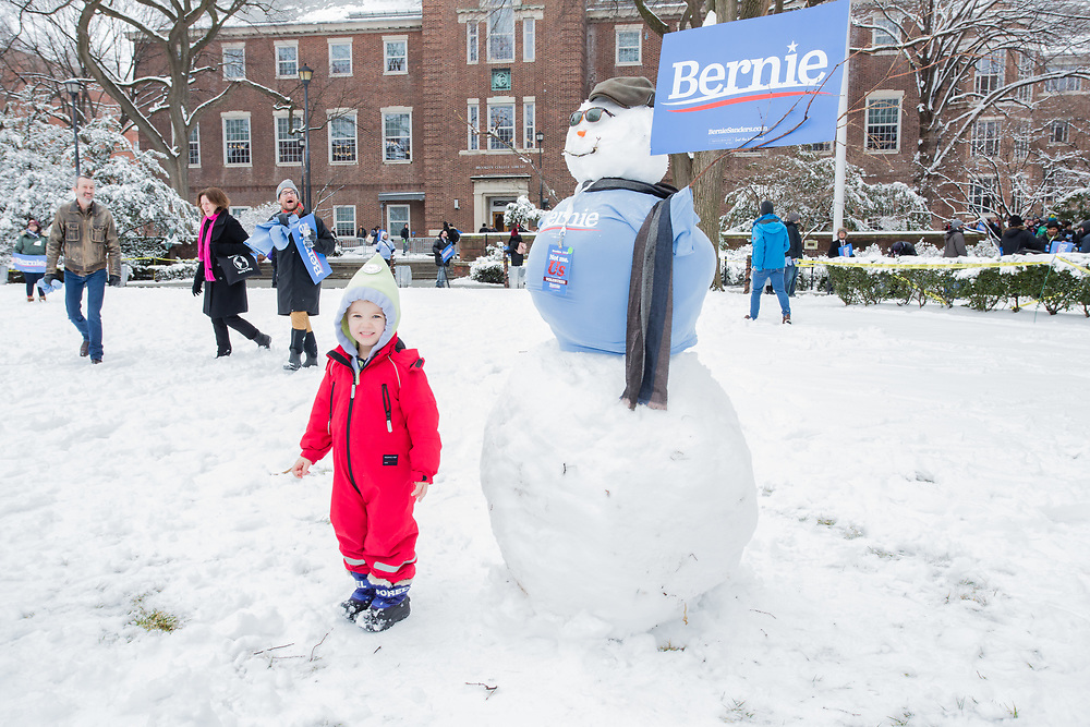 Brooklyn, NY - 2 March 2019. Bernie Sanders' first rally for the 2020 presidential primary at Brooklyn College. A young girl stands beside a snowman wearing a Bernie Sanders t-shirt and carrying a Bernie sign.