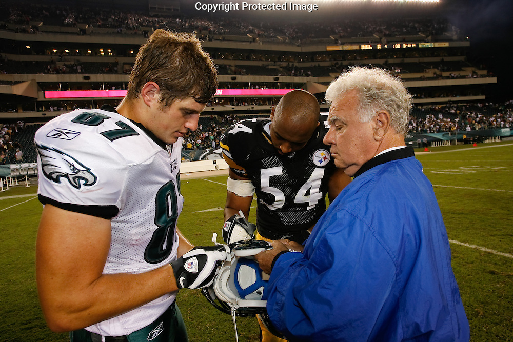 21 Sept 2008: Philadelphia Eagles tight end Brent Celek #87 and Pittsburgh Steelers linebacker Andre Frazier #54 sign a helmet after the game against the Pittsburgh Steelers on September 21st, 2008.  The Eagles won 15-6 at Lincoln Financial Field in Philadelphia Pennsylvania.
