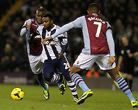 West Bromwich Albion's Stephane Sessegnon in action against Aston Villa's Yacouba Sylla and  Leandro Bacuna.<br /> <br /> Photo by James Marsh/CameraSport<br /> <br /> Football - Barclays Premiership - West Bromwich Albion v Aston Villa - Monday 25th November 2013 - The Hawthorns - West Bromwich<br /> <br /> © CameraSport - 43 Linden Ave. Countesthorpe. Leicester. England. LE8 5PG - Tel: +44 (0) 116 277 4147 - admin@camerasport.com - www.camerasport.com