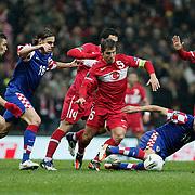 Turkey's Emre BELOZOGLU (C) and Croatia's Darijo SRNA (2ndR) during their UEFA EURO 2012 Play-off for Final Tournament First leg soccer match Turkey betwen Croatia at TT Arena in Istanbul Nüovember11, 2011. Photo by TURKPIX