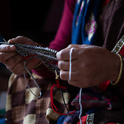 A members of the women's knitting circle works on a future sweater in Ranikhet, India on Dec. 3, 2018.