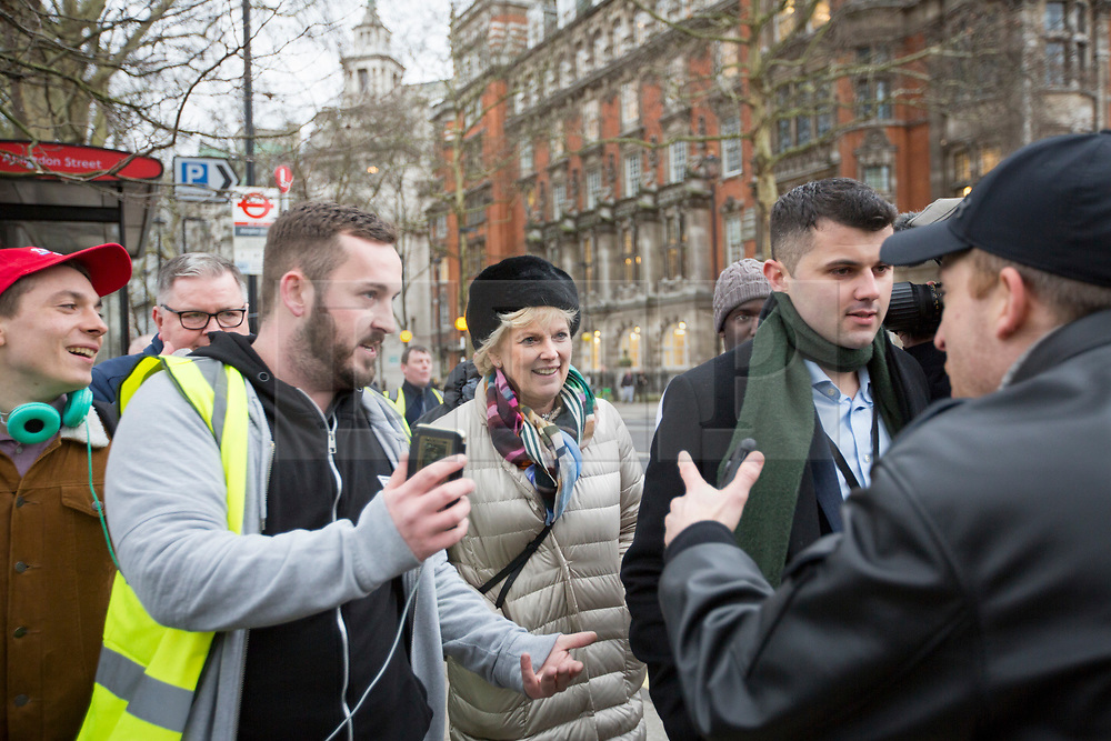 © Licensed to London News Pictures. 07/01/2019. London, UK. Conservative MP and Remain campaigner ANNA SOUBRY is heckled by a group of Brexit supporters, including JAMES GODDARD (third left) as she returns to the Houses of Parliament in London after appearing on broadcast television programs on College Green, Westminster. Photo credit:  George Cracknell/LNP