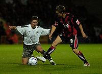 Photo: Leigh Quinnell.<br /> AFC Bournemouth v Bristol City. Coca Cola League 1. 26/09/2006. Bristols Alex Russell slides into a challenge with Bournemouths Shaun Cooper.