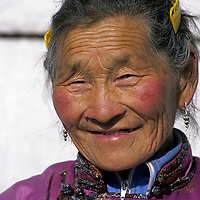 MONGOLIA, Darhad Valley.  Clan matriarch outside her ger (yurt).
