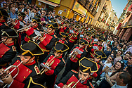 A marching band in the streets of Seville. Andalusia capital has all the superlatives in hosting the biggest, the longest the oldest and the most important of all the Holy Week processions in Spain.