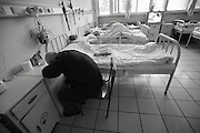 China's Aging Population 7 - A man takes a rest next to his bed at the hospice.