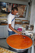 Israel, Acre, The food market in the old city making and selling Knafeh a sweet cheese pastry