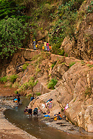 Konso tribe people washing clothes and bathing and filling water containers in the Sagan River, Southern Nations Nationalities and People's Region, Ethiopia.