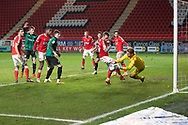 Charlton's Goalkeeper Ben Amos makes a save during the EFL Sky Bet League 1 match between Charlton Athletic and Rochdale at The Valley, London, England on 12 January 2021.