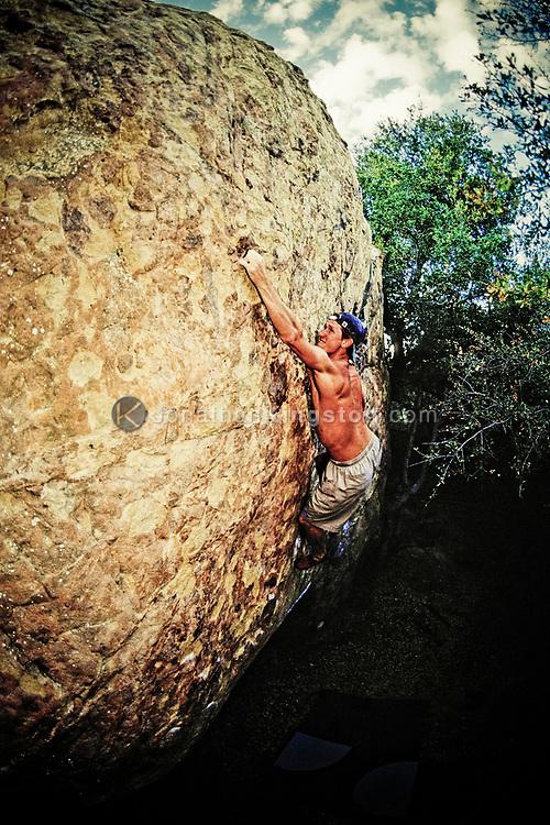 A rock climber, Painted Cave bouldering area, Santa Barbara, CA.(releasecode: jk_mr1012) (Model Released)