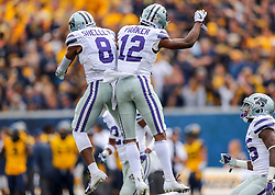 Sep 22, 2018; Morgantown, WV, USA; Kansas State Wildcats defensive back Duke Shelley (8) and Kansas State Wildcats defensive back AJ Parker (12) celebrate after a turnover during the first quarter against the West Virginia Mountaineers at Mountaineer Field at Milan Puskar Stadium. Mandatory Credit: Ben Queen-USA TODAY Sports