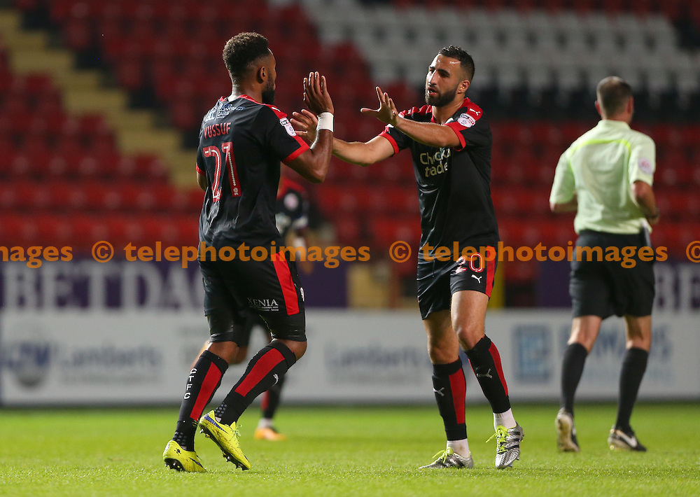 Crawley's Adi Yussuf  celebrates after scoring with Aryan Tajbakhsh during the Checkatrade Trophy match between Charlton Athletic and Crawley Town at The Valley in London. October 4, 2016.<br /> James Boardman / Telephoto Images<br /> +44 7967 642437