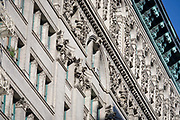 Century old ornate apartment building built in stone, in Manhattan, New York City. 100 year-old stonework like these need to be maintained regularly and inspected by people like Investigative Engineering Services, Assistant Commissioner Tim Lynch, Tim works in the prevention of damage to old and ensuring new buildings are up to standard plus often, assessing the status of a collapsed structure. From the chapter entitled 'The Skyline' and from the book 'Risk Wise: Nine Everyday Adventures' by Polly Morland (Allianz, The School of Life, Profile Books, 2015).