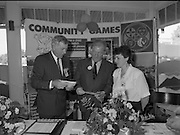 Charles Haughey Visits The Community Games. (T5)..1989..03.10.1989..10.03.1989..3rd September 1989..An Taoiseach, Charles Haughey TD,accompanied by Mr Frank Fahey, TD, Minister of State with responsibility for Youth and Sport attended the Twentieth National Finals of the Community Games at Mosney,  Co.Meath yesterday...Picture shows An Taoiseach, Charles Haughey TD, with games organisers as they study the programme of events for the competitors.