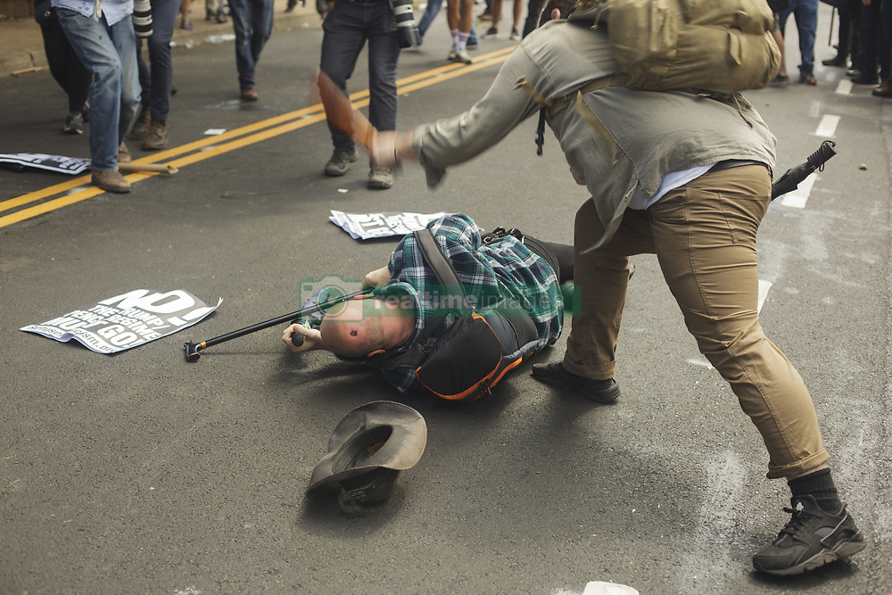 August 12, 2017 - Charlottesville, Virginia, United States - Brawls ensued for about 90 minutes before the police declared the assembly unlawful. The Unite the Right instigated brawls between Antifa and various leftists. The brwal ensued and the White Supremacists/Alt Right supporters were forcibly removed by police. (Credit Image: © Shay Horse/NurPhoto via ZUMA Press)