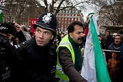 Arguements and scuffles break out between Free Iran demonstrators as police intervene at Stop The War Coalition rally outside the US Embassy in London. Scuffles broke out during the protest, as opposite sides of the arguement shouted each other down. Some of these demonstrators were violently against the extremist views of some of the protesters. The protest is in response to inflamatory language being used by the US and UK concerning Iran and Syria. Free Iran supporters were came in strong numbers, to listen to speakers.