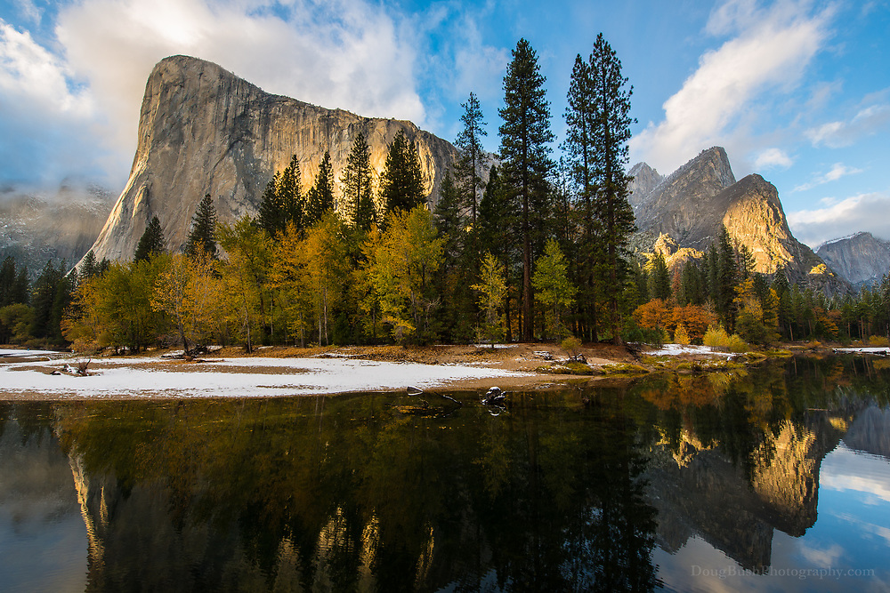 El Capitan and the Three Brothers glow as stormclouds break over Yosemite Valley