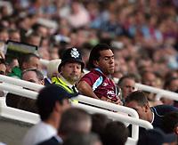 Photo: Chris Ratcliffe.<br /> West Ham United v Aston Villa. The Barclays Premiership. 10/09/2006.<br /> Carlos Tevez of West Ham prepares to come on.
