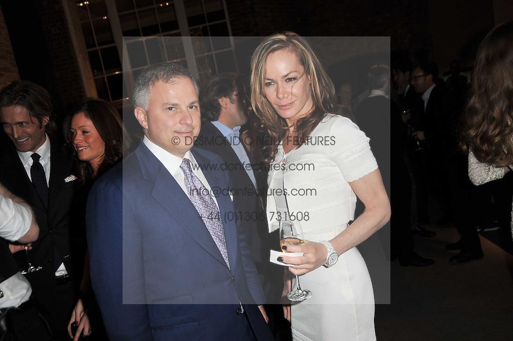 JOHN RIGAS and TARA PALMER-TOMKINSON at the BAFTA Nominees party 2011 held at Asprey, 167 New Bond Street, London on 12th February 2011.