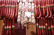 Meat stall with Salamis and sausages ; K?zponti Vásárcsarnok. Central Budapest Market - Hungary .<br /> <br /> Visit our HUNGARY HISTORIC PLACES PHOTO COLLECTIONS for more photos to download or buy as wall art prints https://funkystock.photoshelter.com/gallery-collection/Pictures-Images-of-Hungary-Photos-of-Hungarian-Historic-Landmark-Sites/C0000Te8AnPgxjRg .<br /> <br /> Visit our HUNGARY HISTORIC PLACES PHOTO COLLECTIONS for more photos to download or buy as wall art prints https://funkystock.photoshelter.com/gallery-collection/Pictures-Images-of-Hungary-Photos-of-Hungarian-Historic-Landmark-Sites/C0000Te8AnPgxjRg