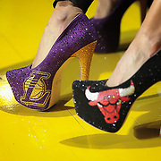 Basketball fans show support for their favorite team with custom high heels during the NBA All-Star game in Houston. ©Travis Bell Photography